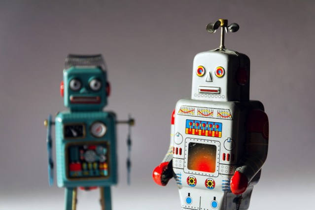 Angry vintage tin toy robots, artificial intelligence