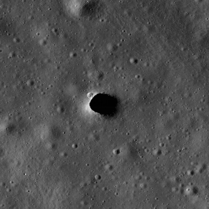 The expansion of the Marius Hills moat shows a small crater at the northwest end and small stones on the south side of the hole.  The hole is about 65 meters in diameter.