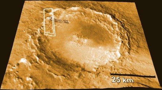El cráter del Mojave en Marte, que se cree que es la fuente de algunos meteoritos marcianos que se encuentran en la Tierra, se muestra aquí en una representación producida por la cámara HIRISE en el Mars Reconnaissance Orbiter de la NASA.