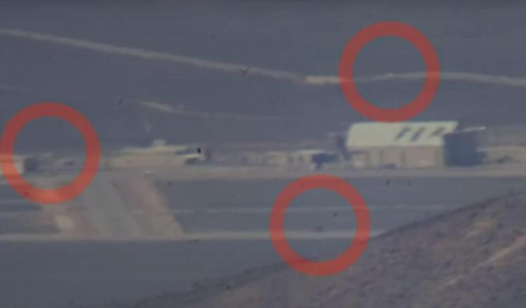 Vehicles can be seen being maneuvered around the base(Area 51)