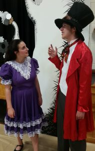 CBNA students Allison Rose (left) as Alice and Cooper Leduke as the Mad Hatter rehearse a scene from Alice in Wonderland