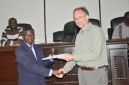 RMU Nautical Sciences department head Stephen Yeboa receives certificate from Brian Arbic