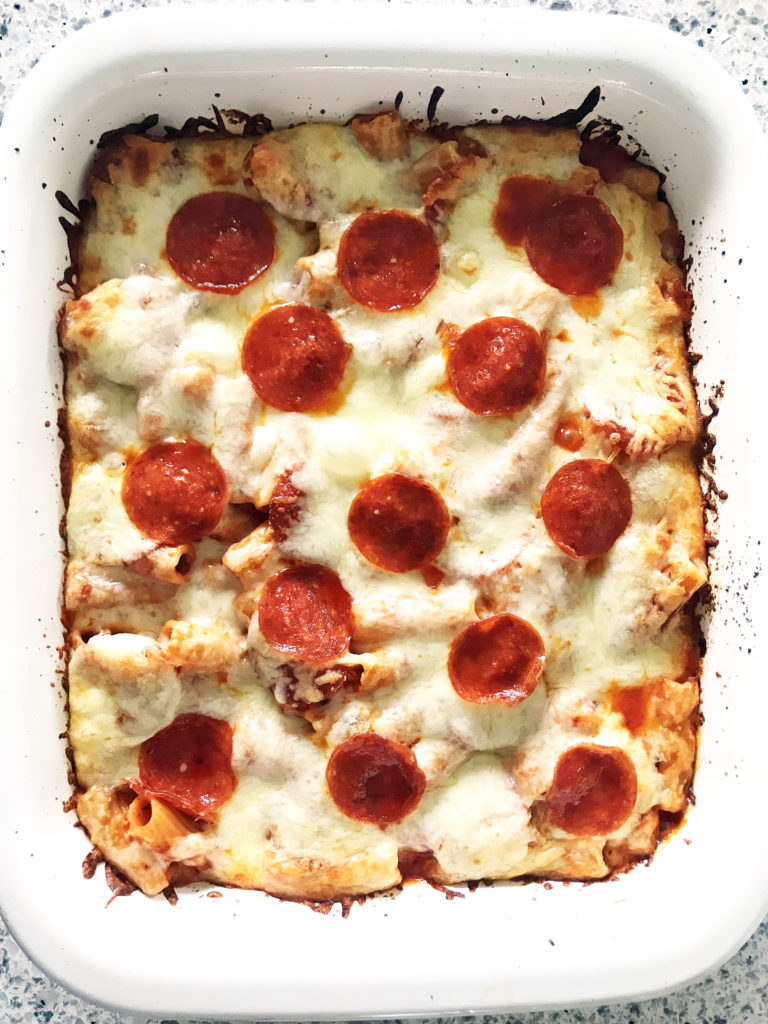 pepperoni pizza casserole in white baking dish