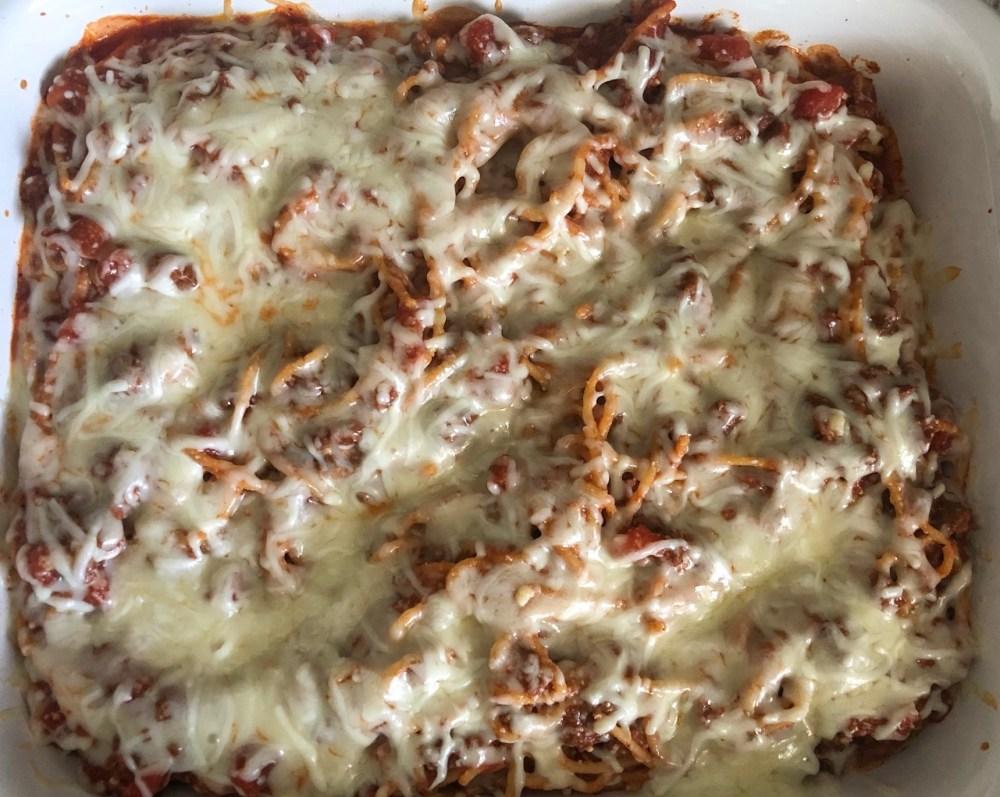 spaghetti in baking dish with mozzarella