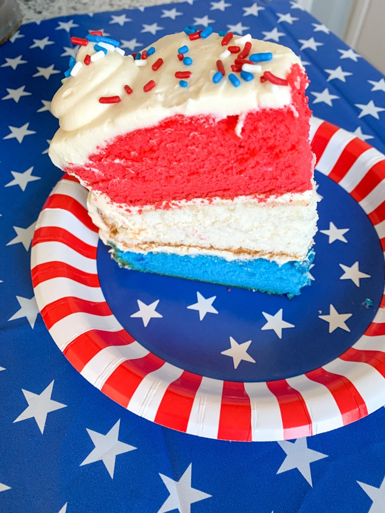 red, white, and blue cake on star plate with star background