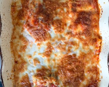 close up of baked ravioli melted cheese on top
