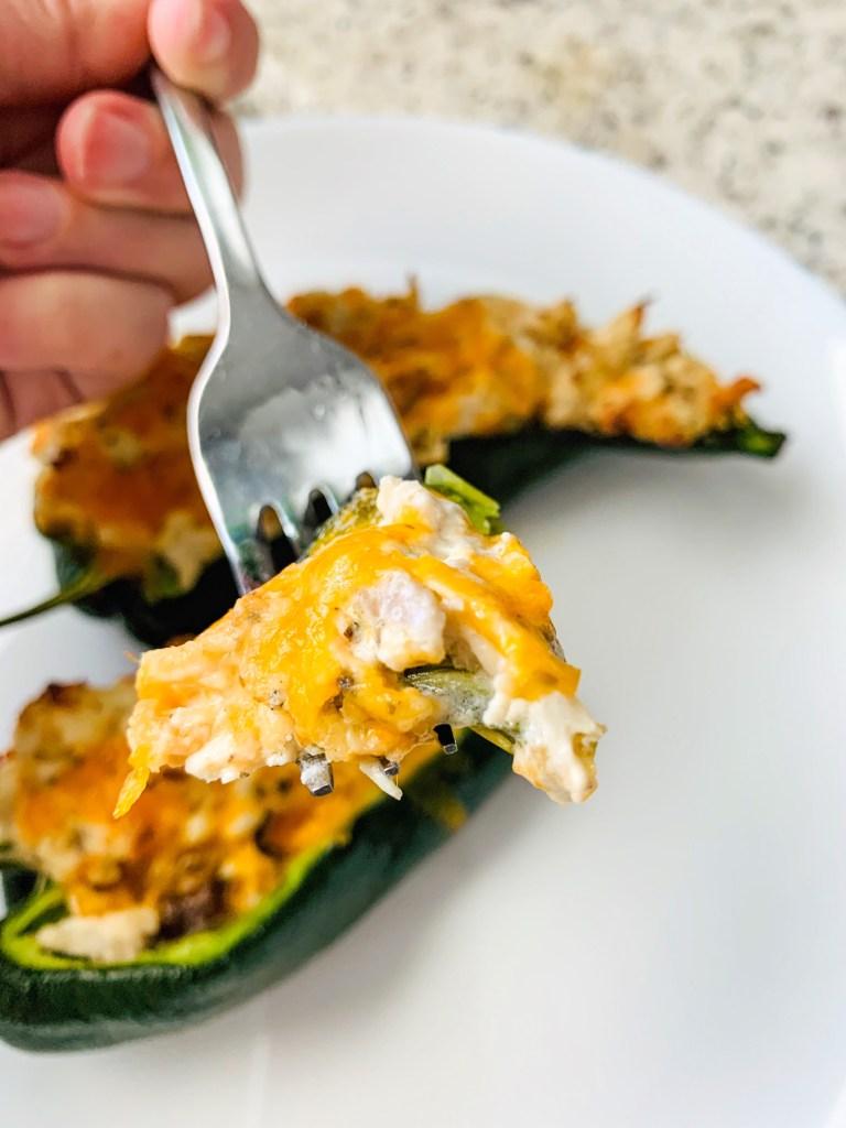 Fork full of stuffed poblano pepper