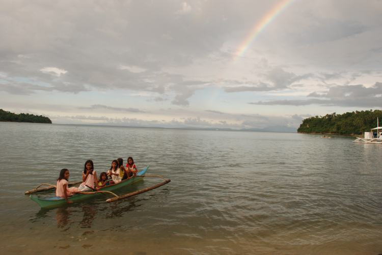 Local children and rainbow, Ticao Island, Philippines
