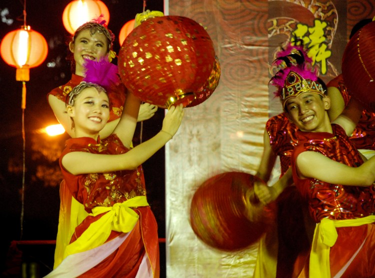 Chinese dancers with lanterns perform at Snake temple for Chinese New Year in Penang