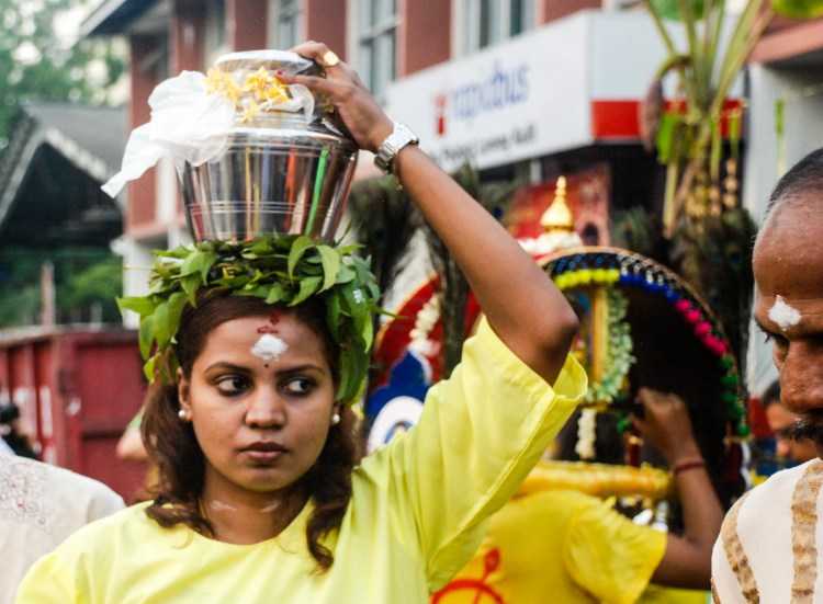 Female milk carrier at Thaipusam in Penang