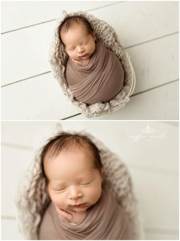 newborn baby boy in wrap inside bucket online newborn workshop model