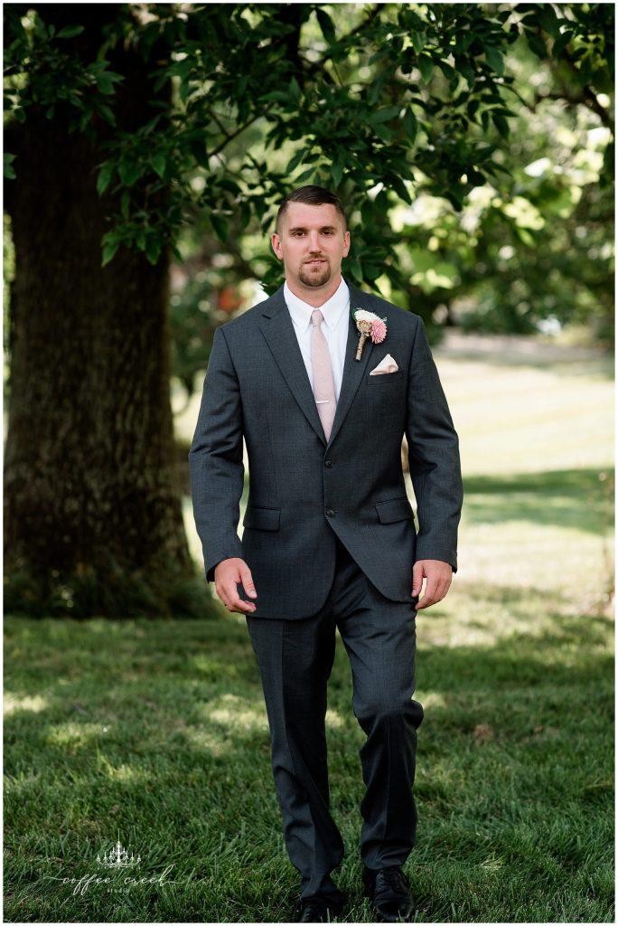 portrait of groom walking
