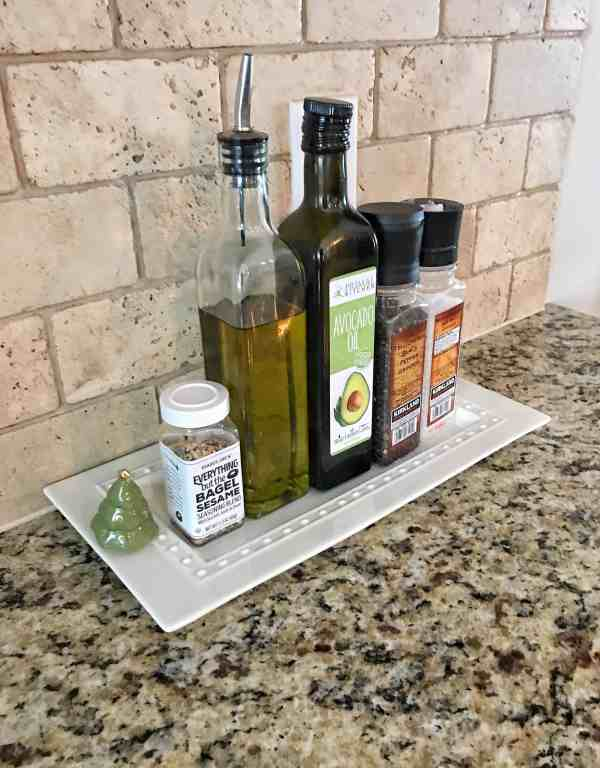 Organize spices and oils on a tray for a farmhouse kitchen element #farmhousedecor #farmhousekitchen #kitchenorganization
