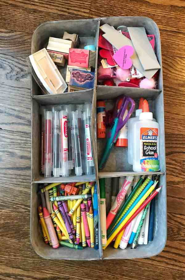 Organize kids craft supplies with a divided caddy #organization #kidsart #artsupplies