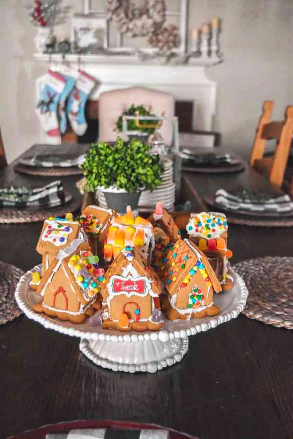 Display gingerbread houses on a pretty pedestal #farmhousedecorating #christmasdecorating #gingerbreadvillage