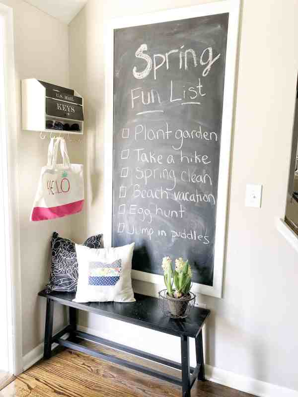 Display your spring fun list on a chalkboard #kitchendecor #chalkboard #farmhouse #rustic #shabbychic #chalkboardwall #fixerupper