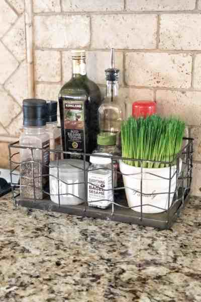 Organize most used kitchen ingredients in a basket for easy access #kitchen #organizationtips #storage