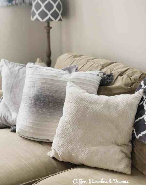 Limit pillows on your couches to declutter and keep room tidy