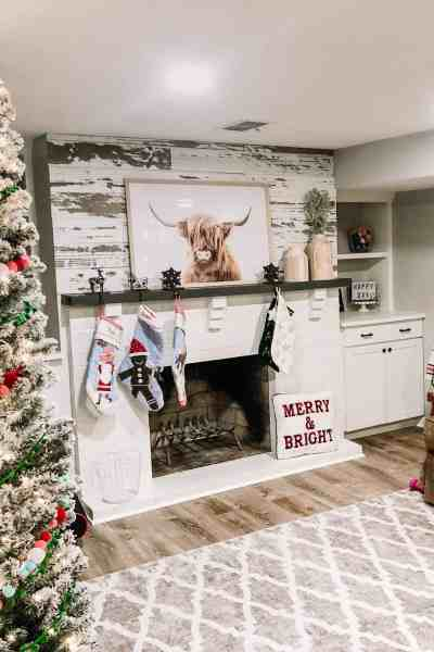 Farmhouse Christmas Playroom Decor #rustic #flockedtree #stockings