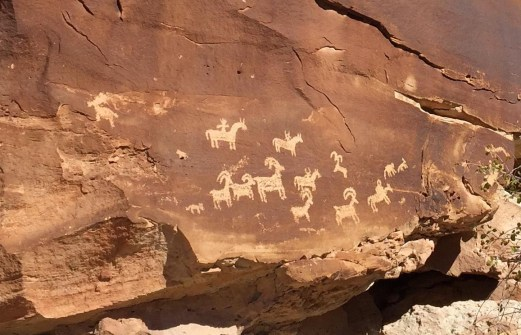 Don't miss the rock art on the way to Delicate Arch.