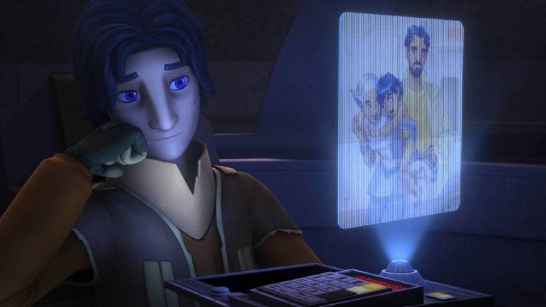 Ezra with picture of parents