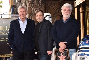 HOLLYWOOD, CA - MARCH 08: (L-R) Harrison Ford, Mark Hamill, and George Lucas at Mark Hamill Star Ceremony on the Hollywood Walk of Fame on March 8, 2018 at Hollywood Walk Of Fame in Hollywood, California. (Photo by Alberto E. Rodriguez/Getty Images for Disney) *** Local Caption *** Mark Hamill; George Lucas; Harrison Ford