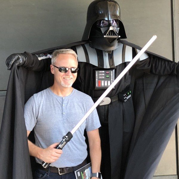 Dennis meets a busker playing Vader in London.