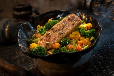 Innovative and creative eats from around the galaxy will be available at Star Wars: Galaxy's Edge when it opens May 31, 2019, at Disneyland Park in Anaheim, Calif., and Aug. 29, 2019, at Disney's Hollywood Studios in Lake Buena Vista, Fla. The Oven-roasted Burra Fish, found at Docking Bay 7 Food and Cargo inside Star Wars: Galaxy's Edge, features Dijon-crusted sustainable fish with mixed greens, roasted vegetables, quinoa and pumpkin seeds with a creamy green curry ranch dressing. (David Roark/Disney Parks)