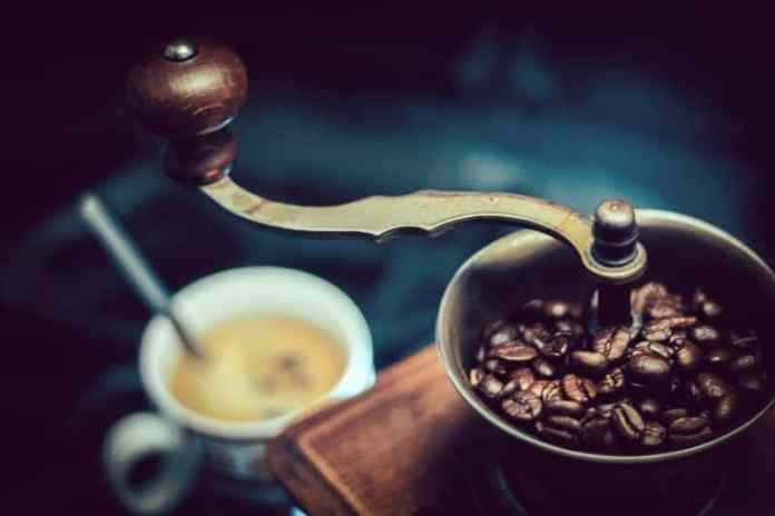 grinding coffee beans before brewing in french press