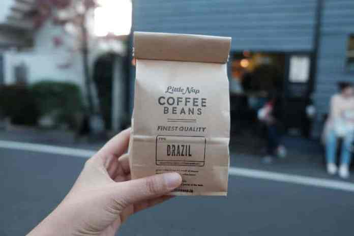 coffee beans in a bag held by a person