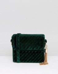 http://www.asos.com/new-look/new-look-quilted-velvet-box-crossybody-bag/prd/7209212?iid=7209212&clr=Darkgreen&SearchQuery=velvet&pgesize=204&pge=0&totalstyles=557&gridsize=3&gridrow=21&gridcolumn=3