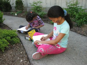Children draw in the Roxbury YMCA garden.