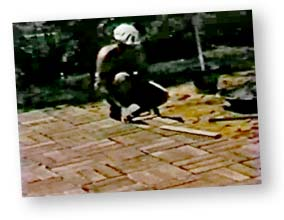 An old photo of Dad making a brick patio at the house the family lived in before I was born.