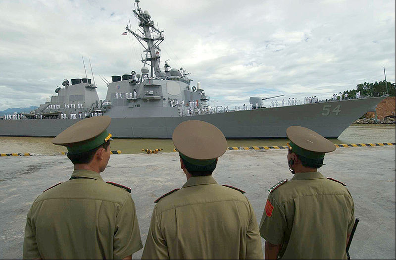 Vietnamese military officials USS Curtis Wilbur prepare to moor in Da Nang. Carl Thayer argues the United States and Vietnam assign different meanings to their partnership agreement.. Source: U.S. Navy photo, U.S. Government work.