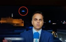 Rome, a UFO flies over the city during a live TV