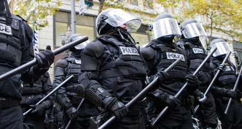 PORTLAND OREGON - NOV 17: Police in Riot Gear Holding the Line in Downtown Portland Oregon during a Occupy Portland protest on the first anniversary of Occupy Wall Street November 17 2011