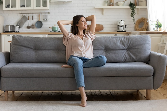 Woman on sofa looking relaxed and happy