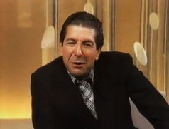 Leonard Cohen (note plaid shirt & dark suit)