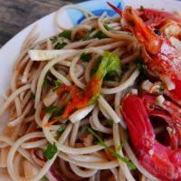 Spaghetti ai frutti di mare e fiori di zucca