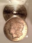 An example of a Morgan Dollar cut in half to match a date with a mintmark to have the coin appear something it is not. Coin was in a counterfeit PCGS slab and caught by one of their graders.