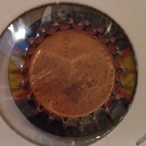 "A 1953-D Lincoln Cent is ""trapped"" inside this Dad's Root beer bottle cap"