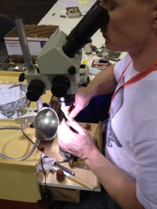 A modern Buffalo Nickel artist carves coins at the FUN Show