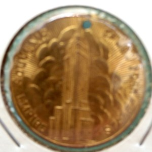 Obverse of the holed Empire State Building medal.