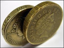Detecting counterfeit &pound coins, the genuine coin has edge lettering (left), the counterfeit does not.