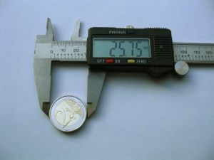 Digital caliper measuring a €2 coin.