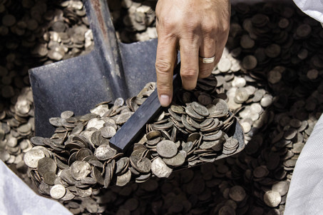 Hong Kong-based Wealthy Max Ltd. publicly opened and sampled 13 tonnes of mutilated U.S. coins waiting for shipment in Hong Kong.