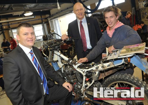 Second-year motorcycle mechanic Raymond Cole, right, shows Corangamite MP Darren Cheeseman, left, and School Education Minister Peter Garrett Colac Secondary Colleges trade training centre.