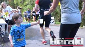 Apollo Bay youngster Lucas Humphries handed out  drinks to competitors during their run on Saturday.