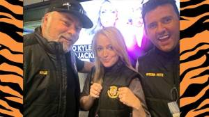 Sydney Radio hosts Kyle and Jackie O and former Simpson man Peter Deppeler wore Simpson Football Club vests to show support for the club in the lead-up to the Tigers' senior grand final tomorrow. Simpson is competing in its first Colac District Football League senior grand final.