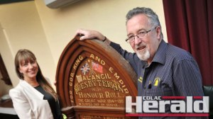 Colac RSL manager Bryan Hunt and Karen Jarvis in front of a First World War honour board the RSL wants to restore. Ms Jarvis is helping co-ordinate fundraising efforts to raise money for the honour board's restoration.